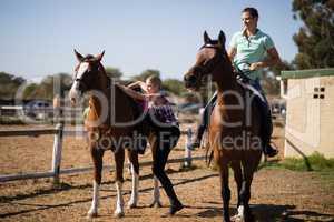 Female friends preparing for horse background