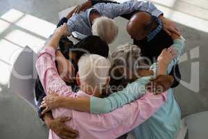 High angle view of senior friends huddling