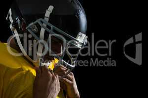 American football player with a head gear