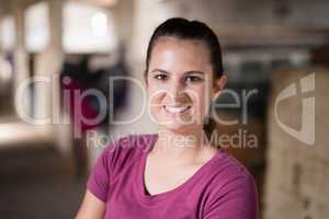 Close up portrait of smiling female jockey