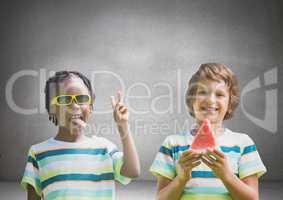Boys with watermelon and sunglasses in front of grey background