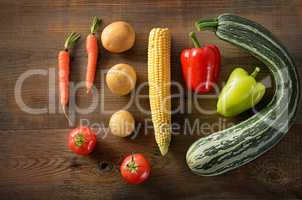 Healthy food background .Different vegetables on old wooden tabl
