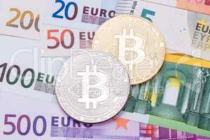 Euros and dollar background covered with golden and silver bitco