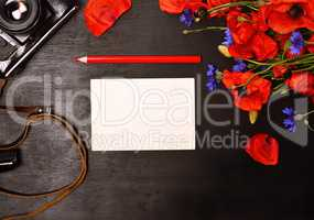 blank greeting card and a red pencil