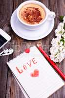 Notepad in a line with an inscription red love pencil