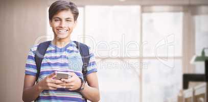 Composite image of portrait of happy boy using phone
