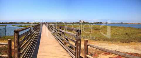 Bridge along the peaceful and tranquil marsh of Bolsa Chica wetl