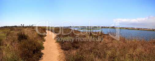 Path along the peaceful and tranquil marsh of Bolsa Chica wetlan