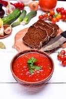 Soup gazpacho in a brown plate