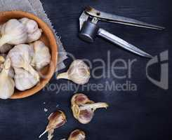 Fruits of garlic in a wooden bowl