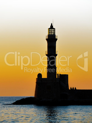Lighthouse silhouette at sunset.