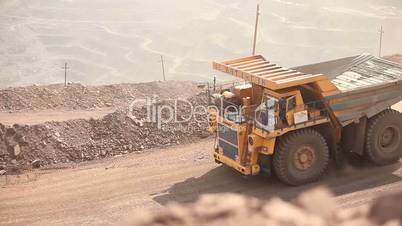 Dumper goes on a career, the general plan, the big yellow dumper in a quarry