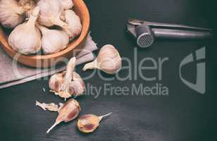 Fruit of garlic in a wooden bowl