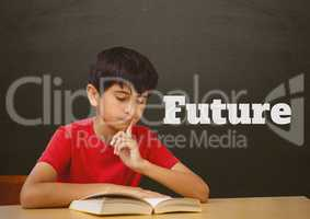Student boy at table reading against grey blackboard with future text