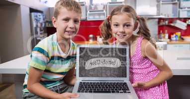 Kids looking at a computer with school icons on screen