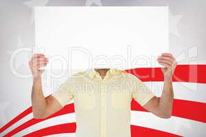 Composite image of man holding card in front of his face