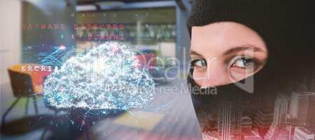 Composite image of portrait of female hacker wearing balaclava