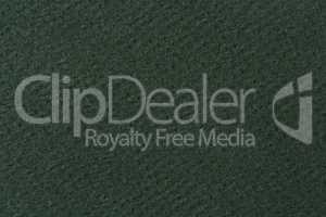 Textured green paper texture on macro.