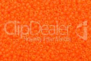 Many orange glass beads.