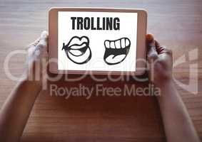 Trolling text and mouth cartoons on tablet in hands