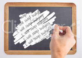 Hand writing I will stop bullying on blackboard