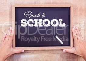 Back to school text on blackboard with chalk