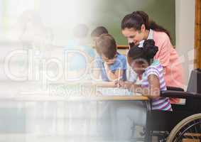 Elementary school teacher with class and disabled girl in wheelchair