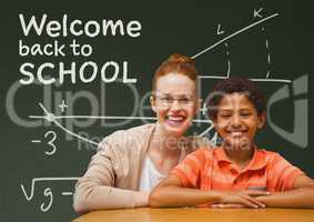 Student boy and teacher at table against green blackboard with welcome to school text