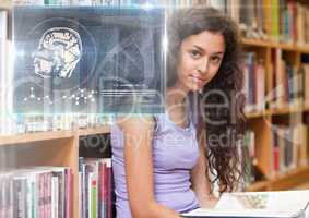 Female Student studying with book and science education interface graphics overlay