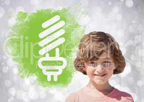 Boy next to light bulb green energy