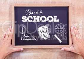 Back to school text on blackboard with chalk and stationery