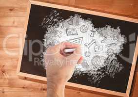 Hand drawing education graphics on blackboard