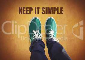 Keep it simple text and Green shoes on feet with rustic background