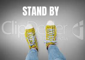 Stand by text and Yellow shoes on feet with grey background