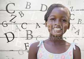 Many letters around Girl with bright wooden background