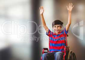 Disabled boy in wheelchair in front of blurred background