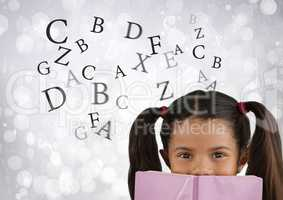 Many letters around Girl reading in front of bright bokeh background