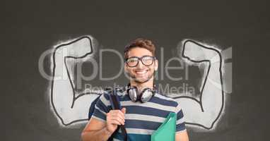 Happy student man with fists graphic standing against grey blackboard