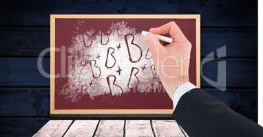 Hand writing B+ grade letters on blackboard