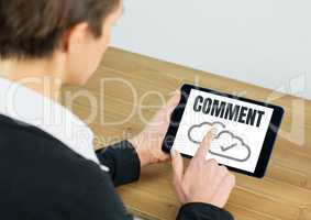 Comment text and cloud tick graphic on tablet screen with hands