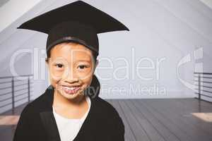 Composite image of portrait of smiling girl wearing mortarboard