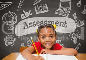 Happy student girl at table against grey blackboard with assessment text and education and school gr
