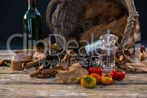 Spice by container on wooden table
