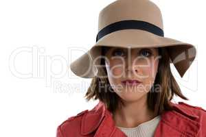Close up portrait of young woman wearing hat