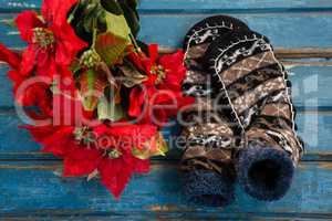 Poinsettia by socks on table