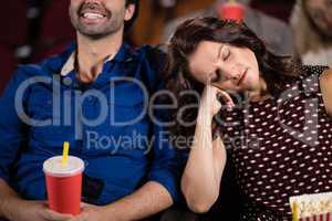 Woman sleeping in theatre