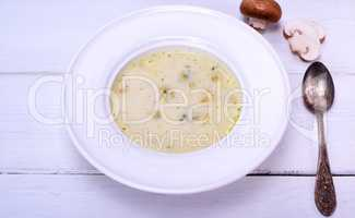 Mushroom soup in a white round plate