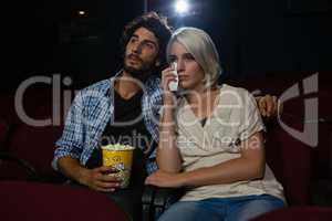 Couple getting emotional while watching movie