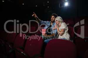 Couple with shocked expression looking at the movie