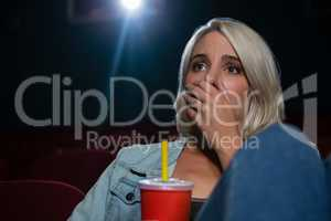 Woman with shocked expression looking at the movie
